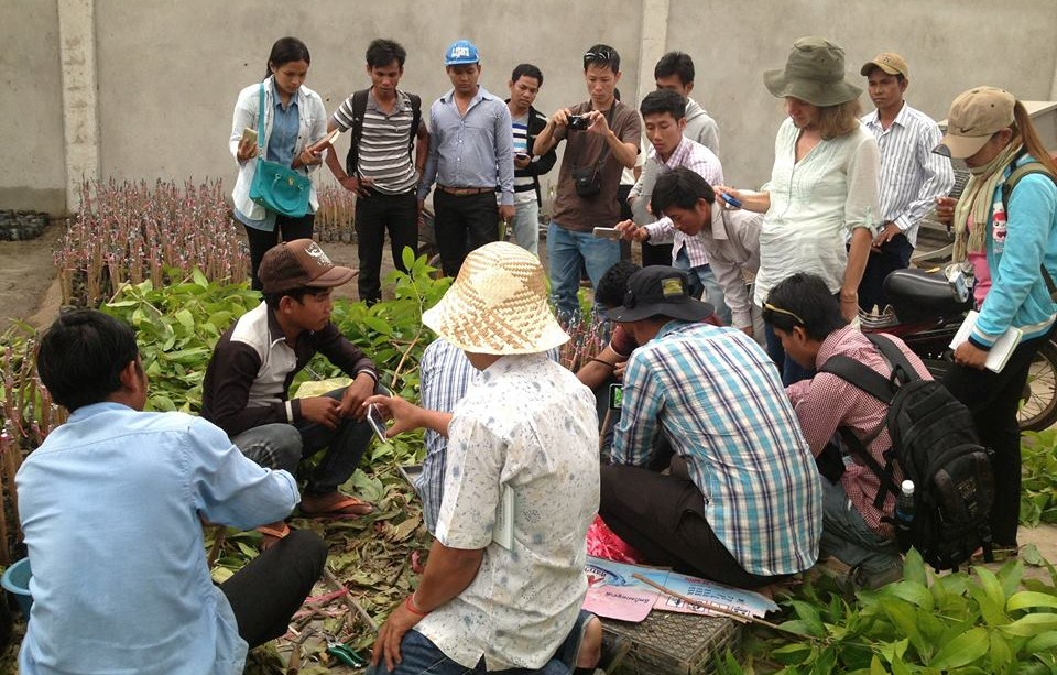 AfID volunteer with charity partners in Cambodia