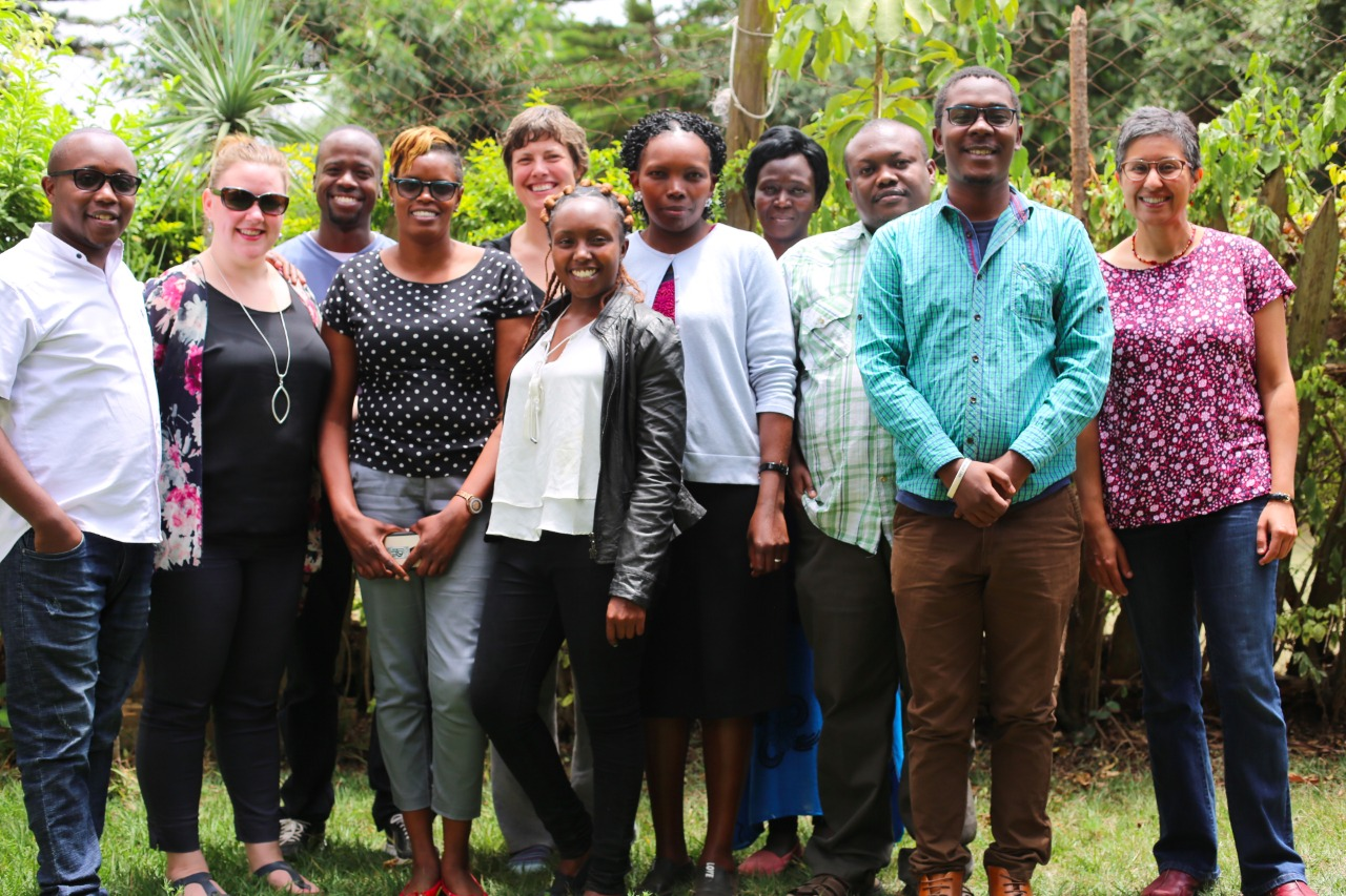 AfID volunteer with hosts in Kenya
